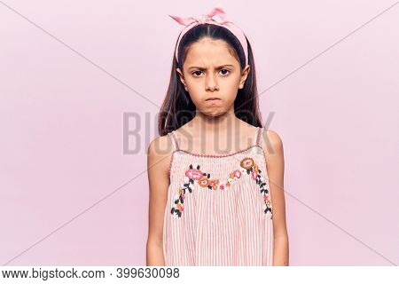 Beautiful child girl wearing casual clothes skeptic and nervous, frowning upset because of problem. negative person.