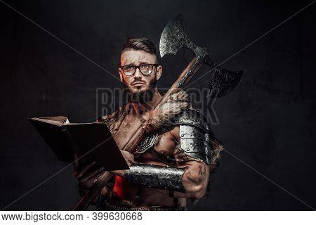Sad Nordic Warrior In Light Armour With Fur With Eyeglasses And Book Holding Huge Axe On His Shoulde