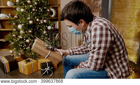 Depressed Man, Isolation At Home, Quarantine Covid-19 Pandemic On Christmas. Pessimistic Guy Feels T
