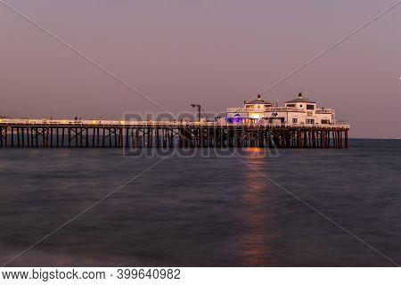 Malibu, California - Aug 27, 2020: Malibu Pier Along Malibu Beach At Sunset In Malibu, California.