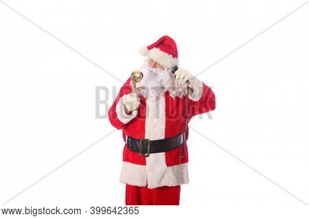 Santa Claus talks on his Telephone. Santa talks to a lucky boy or girl about what they would like for Christmas on his Telephone. Santa Claus orders Pizza for lunch in the North Pole. Isolated.