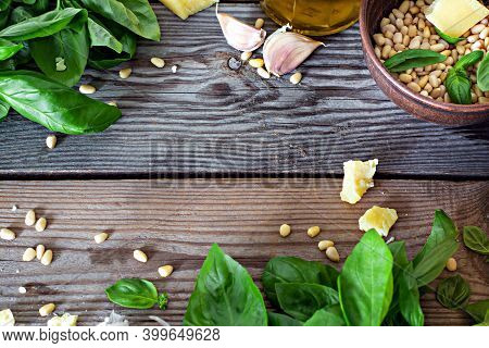 Layout Of Products For Pesto Sauce (green Pesto) On A Wooden Background, Flatlay. Basil Leaves, Nuts