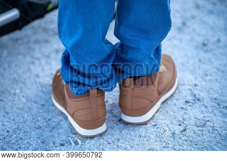Mens Winter Boots On Snow. Brown Mens Warm Winter Boots Closeup