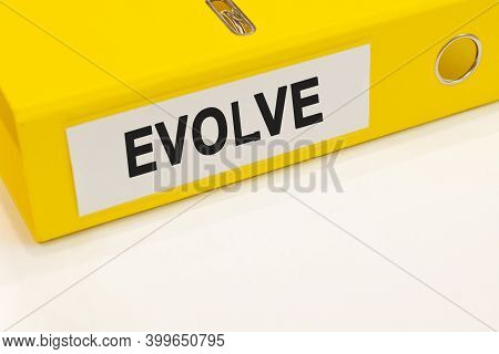 The Word Evolve On A White Background With A Yellow Folder. Business Concept