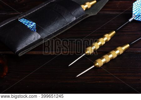 Darts For Playing Darts On A Dark Wooden Background. Darts Game.