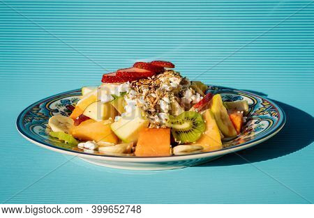 Exquisite Healthy Fruit Salad With Melon, Kiwi, Pineapple, Green And Red Apple, Guava, Strawberries