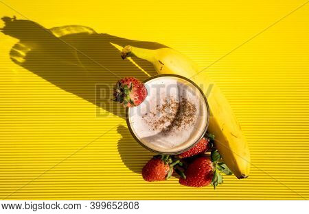 Exquisite Healthy Strawberry And Banana Shake Inside A Strawberry Glass With A Banana On The Side Re