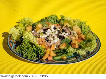 Exquisite Healthy Salad With Croutons, Lettuce, Tomato, Ham, Tuna, Cheese And Fruits On Top, On A Ha