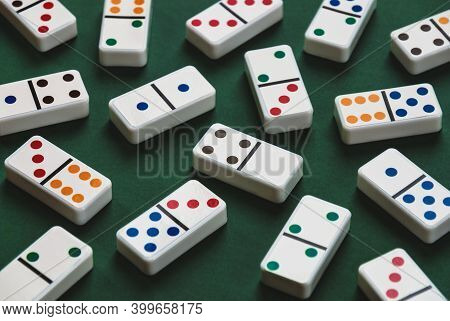 Domino Tiles On Pocker-green Table, Dominoes Background Close Up