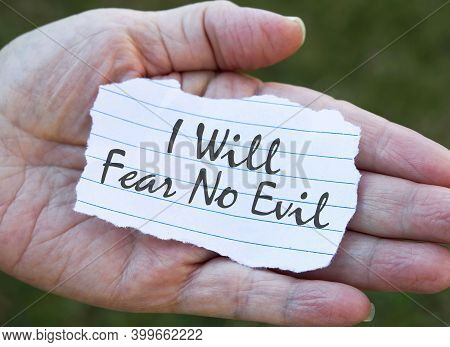 Paper Note In Hand, I Will Fear No Evil.