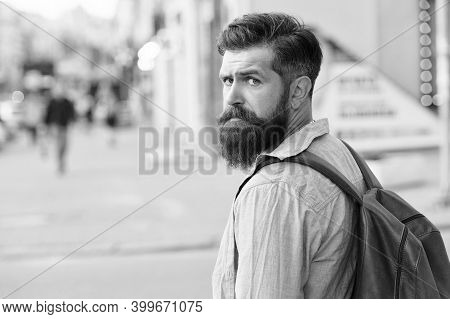 Backpack For Urban Traveling. Hipster Backpack Urban Street Background. Tourism And Backpacking. Vac