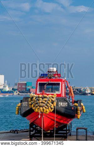 Gunsan, South Korea; November 17, 2020: Korean Police Patrol And Rescue Boat Dry Docked On Pier.