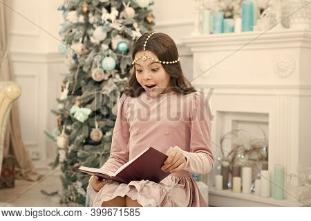Christmas Surprise. Surprised Child Read Surprising Story On New Year. Small Girl Keep Mouth Opened