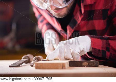 Carpenter, Joiner At Work In The Workshop.