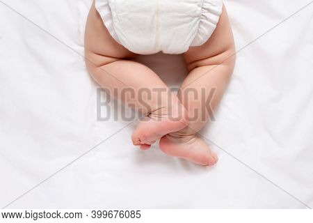 Cute Caucasian Infant Baby In White Nappy On Light Grey Blanket. Top View. Banner Format. Copy Space