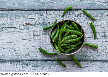 View Of Green Chilies In A Bowl. Green Chilies Commonly Used In Asian Cuisine.