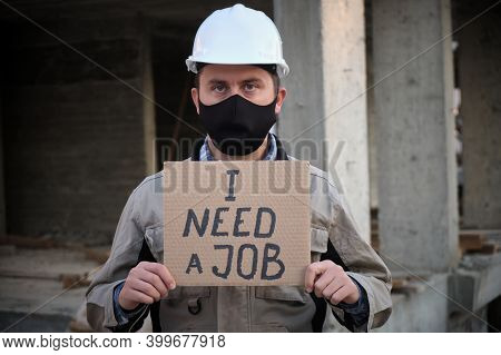 Engineer In Mask And Hardhat Stands With Placard I Need A Job