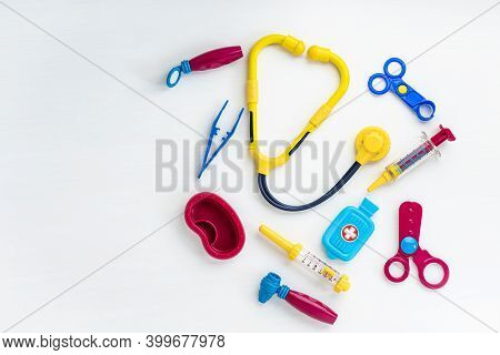 Childrens Medical Instruments. Childrens Doctor Concept. Pediatrics. Toy Medical Devices On A White