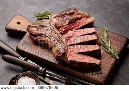 T-bone grilled beef steak with spices and herbs