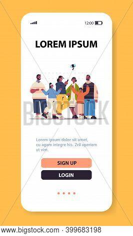 Multigenerational African American Family Using Selfie Stick Taking Photo On Smartphone Camera Verti