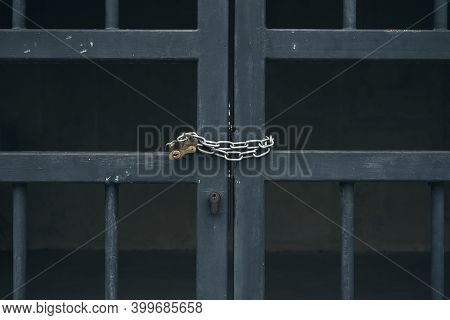 Details Of Closed Metal Gates, Chain And Lock Closeup.