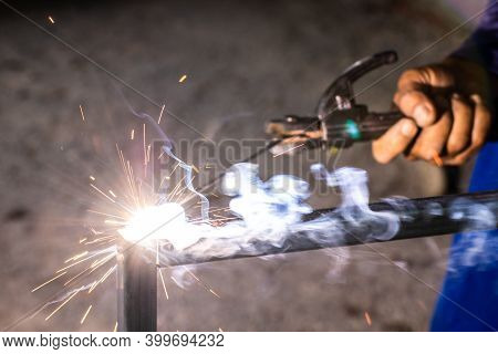 Welder And Welding Sparks, Construction And Metal Work Industrial Concept, Metal Welding With Sparks