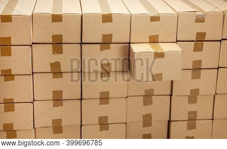 Cardboard Boxes For Delivery Or Moving. One Box Is Special And Taken Out. Stack Of Boxes
