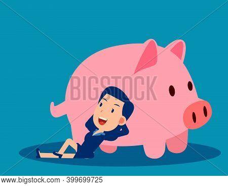 A Businesswoman Reclines Close To The Piggy Bank. Saving Money Concept
