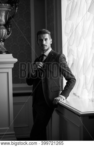 Groom At Wedding Day Smiling And Waiting For Bride In Hall Of Hotel. Elegant Rich Man In Costume
