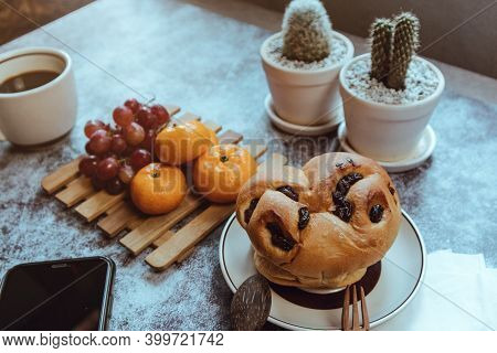 Rustic Breakfast, Bread And Fruit On The Dining Table.