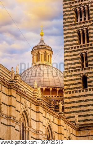 Bell Tower And Dome Of The Siena Cathedral Or Duomo Di Siena In Tuscany, Italy