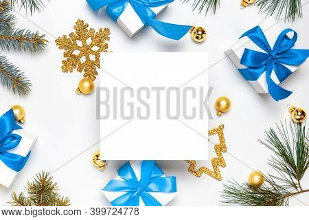 Noel Design. White Gift Box With Blue Ribbon, New Year Balls And Christmas Tree On White Background