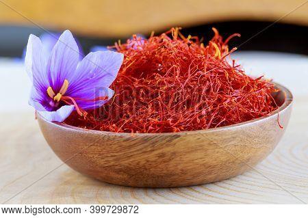 Stigmas Of Saffron And Crocus Flower In A Wooden Plate. Cooking Saffron . Saffron Crocus Flowers.