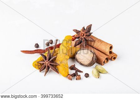Dry Warming Indian Spices For Autumn And Winter Meal On White Concrete Background. Exotic Vitamin, F