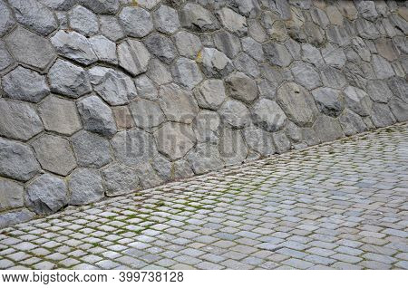 The Embankment In The Dock Shore Is Fortified By A Sloping Retaining Wall Of Kykop Masonry. Roughly