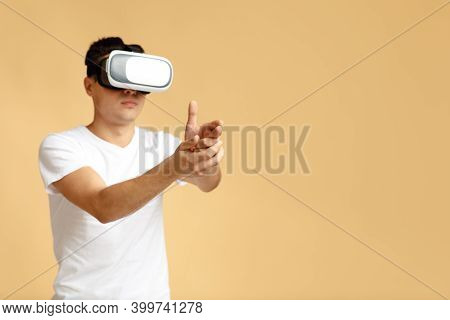 Modern Entertainment, Online Games And Technology For Fun. Serious Young Student Man In Virtual Real