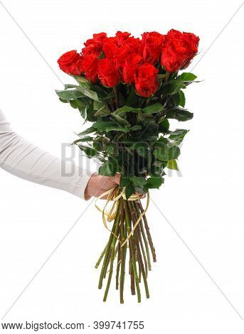Female Hand Holding A Beautiful Bouquet Of Bright Red Roses With A Long Stem On A White Background.