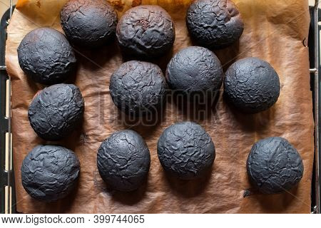 Top View Of Burnt Cakes From The Oven.