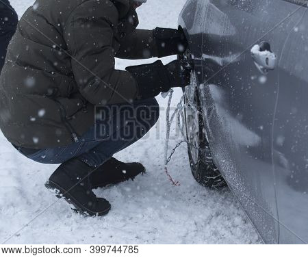 Putting On Snow Chains On A Car