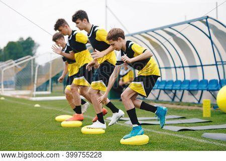 Sports Balance Training. Stability Soccer Training On Balance Cushion. Young Soccer Players Improvin
