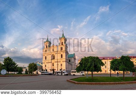 Grodno, Belarus - May 27, 2019: Famous Landmark Is St. Francis Xavier Cathedral At Illuminated By Th
