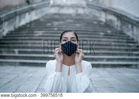 Worried Depressed Woman Wearing Reusable Fabric Face Mask During Coronavirus Covid-19 Outbreak.emoti