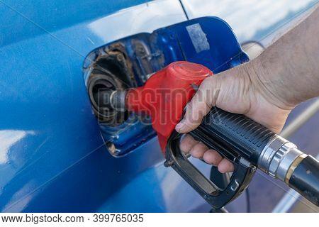 A Man Refuels A Car. Refueling Gun
