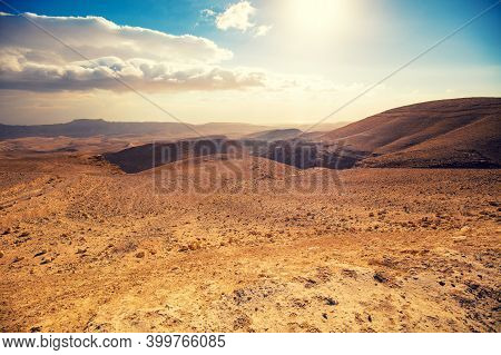 Mountainous Desert With A Beautiful Cloudy Sky. Desert In Israel At Sunset