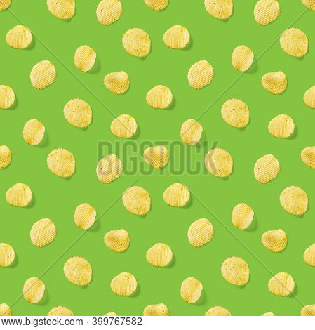 Seamless Pattern Made From Potato Chips On Green Background Flat Lay. Potato Snack Chips Isolated Fa