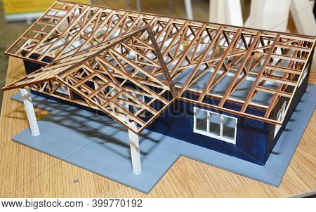 A Modern House Construction Scale Model, Miniature Architecture Project  With A Detailed Wooden Roof