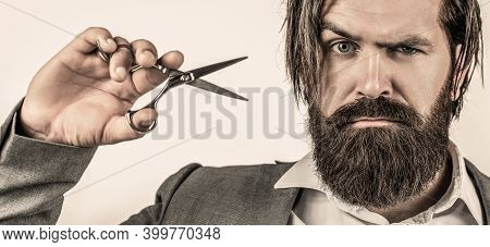 Barber Scissors. Bearded Man Isolated On Gray Background. Mans Haircut In Barber Shop. Barber Scisso