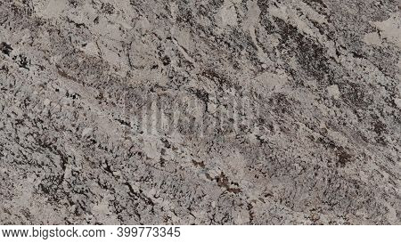 Natural Alaska Grey Granite Stone Texture Background. Alaska Grey Granite Surface For Interior And E