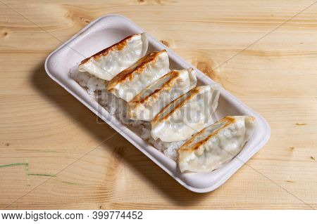Japanese Food Called Gyoza Served On White Plate
