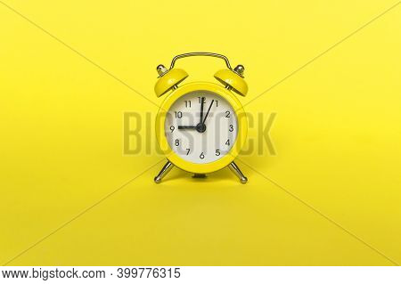 Ringing Twin Bell Vintage Classic Alarm Clock Isolated On Yellow Background. Rest Hours Time Of Life